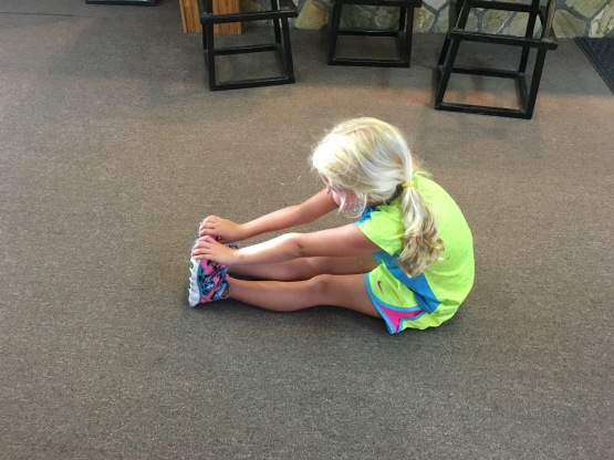 7.17.16  Reece Post-Tourney stretch in the clubhouse!