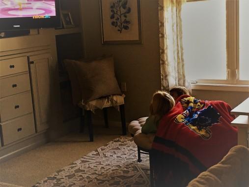 4.23.17 littles watching cartoons.JPG